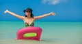 Young perfect woman on an air mattress in the sea this image has attached release Royalty Free Stock Image