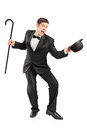 Young performer with cane and hat gesturing Royalty Free Stock Images