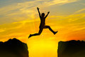 Young person jumping over the mountains Royalty Free Stock Photo