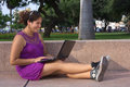 Young Peruvian Woman with Laptop in Park Stock Images