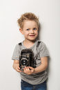 Young photographer little boy hold vintage camera studio portrait over white background Stock Images