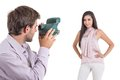 Young photographer taking photos of beautiful hispanic model with instant camera isolated on white Stock Images