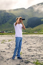 Young photographer is taking a picture in Norway Royalty Free Stock Photo