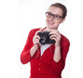 Young photographer with vintage camera girl bi smile posing as a holding on white background Royalty Free Stock Photography