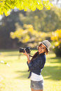 Young photography student cheerful take photos outdoors at the park Royalty Free Stock Photos