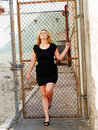 Young plump caucasian woman black dress Royalty Free Stock Images