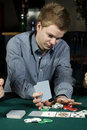 Young poker player going all in Royalty Free Stock Images