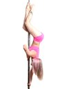 Young pole dance woman make basic invert isolated Royalty Free Stock Photos