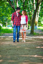 Young pregnant couple walking spring park in colorful Royalty Free Stock Images