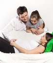 Young pregnant family relaxing on the sofa Royalty Free Stock Photography