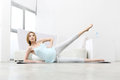 Young pregnant woman doing leg swing beautiful Stock Image