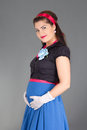 Young pregnant woman retro clothes over grey Royalty Free Stock Photography