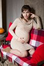 Young pregnant woman sitting on sofa see my other works in portfolio Royalty Free Stock Photography