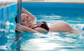Young pregnant woman in swimming pool Royalty Free Stock Photography