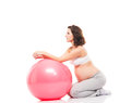 Young pregnant woman training with a fitness ball and healthy on white Stock Photography