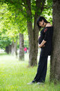 Young pregnant woman on walk the girl in city park Stock Image