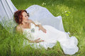 Young pregnant woman in white dress the garden Stock Photo