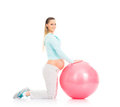 A young pregnant woman working out with a fitness ball Stock Images