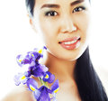 Young pretty asian woman with flower orchid close up isolated sp Royalty Free Stock Photo