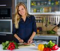 Young pretty blond woman cooking Royalty Free Stock Photo