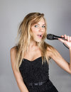 Young pretty blond woman sing Royalty Free Stock Photos