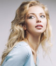 Young pretty blond woman smiling on white Royalty Free Stock Photo