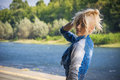 Young Pretty Blond Woman in Trendy Denim Fashion Outdoor Royalty Free Stock Photo