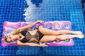 Young pretty blonde woman on air mattress swimming pool Royalty Free Stock Photo