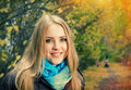 Young pretty blonde woman in the autumn park Stock Photos