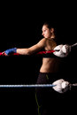 Young pretty boxer woman on the black Royalty Free Stock Photo