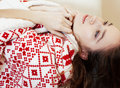 Young pretty brunette girl in Christmas ornament blanket getting warm on cold winter, freshness beauty concept Royalty Free Stock Photo