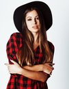 Young pretty brunette girl hipster in hat on white background ca Royalty Free Stock Photo