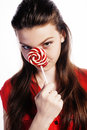 Young pretty brunette girl with red candy posing Royalty Free Stock Photo