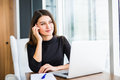 Young pretty business woman with notebook in the bright modern office Royalty Free Stock Photo
