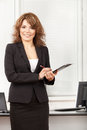 Young pretty business woman in the office with Stock Image