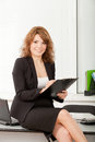 Young pretty business woman in the office with Royalty Free Stock Photos