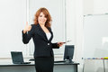 Young pretty business woman in the office with Royalty Free Stock Photography