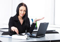 Young pretty business woman in the office with Royalty Free Stock Image