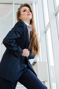 Young pretty business woman wearing man's suit in office Royalty Free Stock Photo