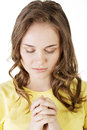 Young pretty caucasian girl praying over white background Royalty Free Stock Image