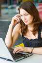 Young pretty caucasian lady working seriously Royalty Free Stock Photo