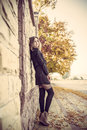 Young pretty elegant lady posing near urban light wall at vintag Royalty Free Stock Photo
