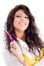 Young pretty female holding toothbrush Stock Photography
