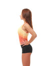 Young pretty fitness model in orange top and black shorts standing profile Royalty Free Stock Image