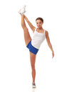 Young pretty fitness model in white top and blue shorts performing a standing twine Stock Photography