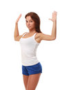 Young pretty fitness model in white top and blue shorts stretching a chest Royalty Free Stock Photos