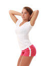 Young pretty fitness model in white top and red shorts Stock Photography