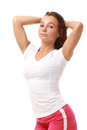 Young pretty fitness model in white top and red shorts Stock Photos