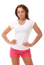 Young pretty fitness model in white top and red shorts Royalty Free Stock Photo