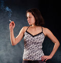 Young pretty girl with a cigarette Royalty Free Stock Photo